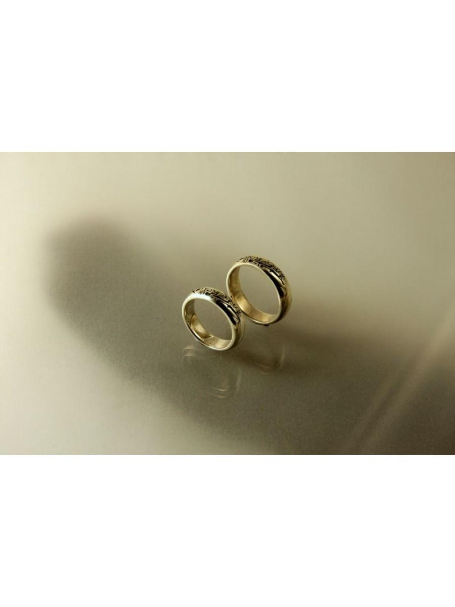 Napba iramló szarvasok karikagyűrű